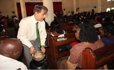 Emerging Cooking Solutions demonstrates a stove in a church in Lusaka, Zambia.
